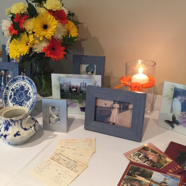 Memorial Table with Candle and Flowers